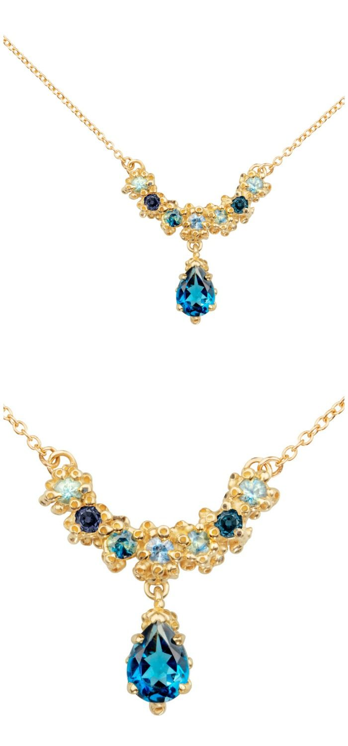 A beautiful handmade necklace by Ruta Reifen, with blue sapphires and topaz ston...