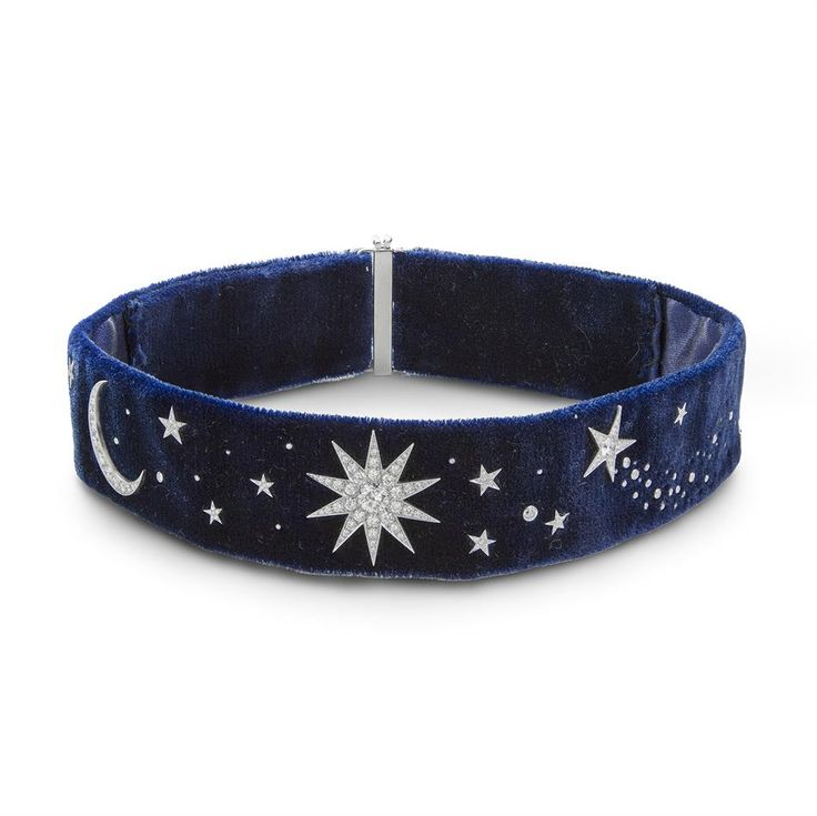 A diamond and velvet stars and moon collar necklace.