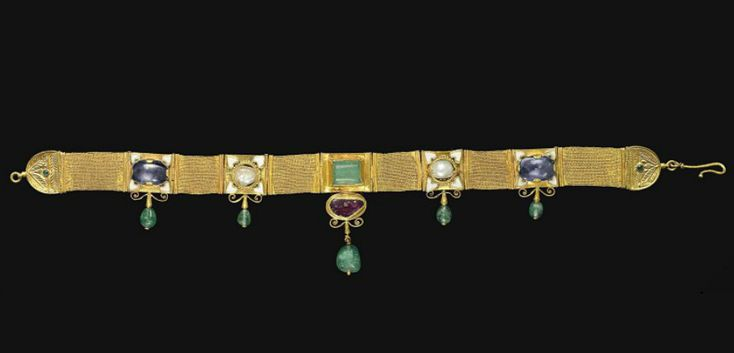 A gold, sapphire, emerald, spinel and enamel strap necklace, 6th/7th century a.d...