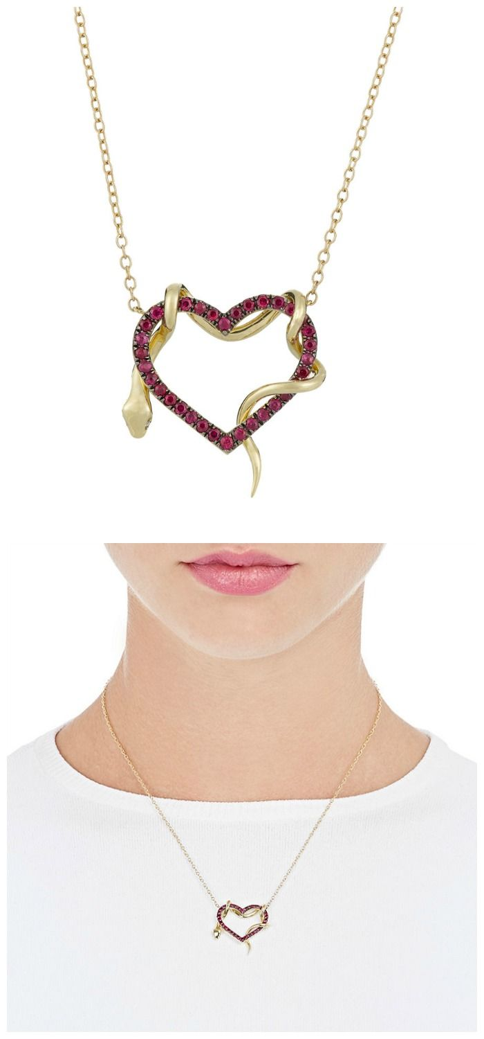 A heart and snake pendant necklace by Finn. In gold, with rubies on the heart an...