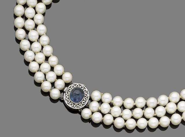 A three-strand cultured pearl necklace and sapphire clasp The three rows of 7.00...