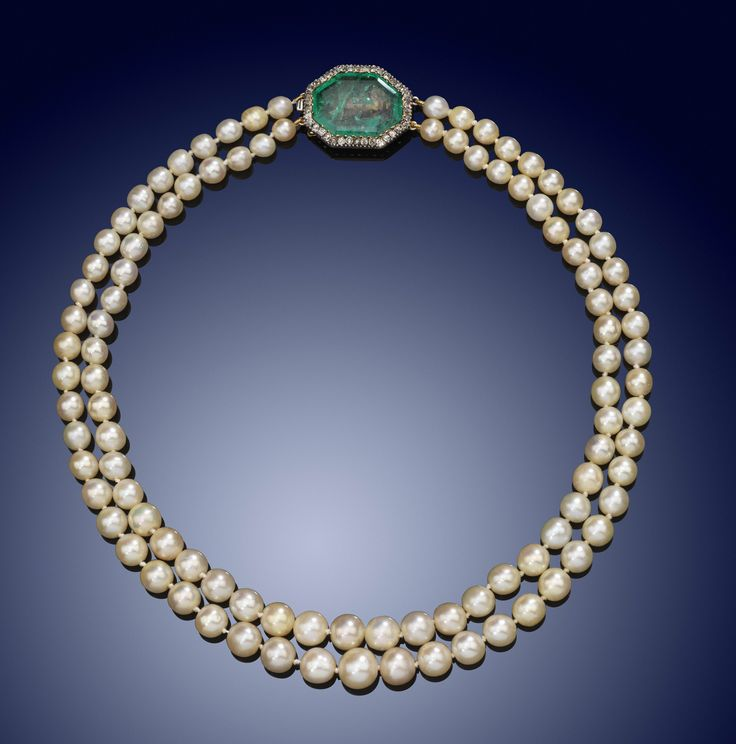 A two row natural pearl necklace with emerald and diamond clasp - Lot 1881 - Jew...