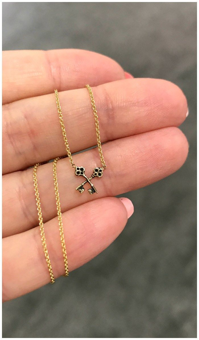 I love this itty bitty crossed key necklace from Pyrrha's new 14K gold colle...