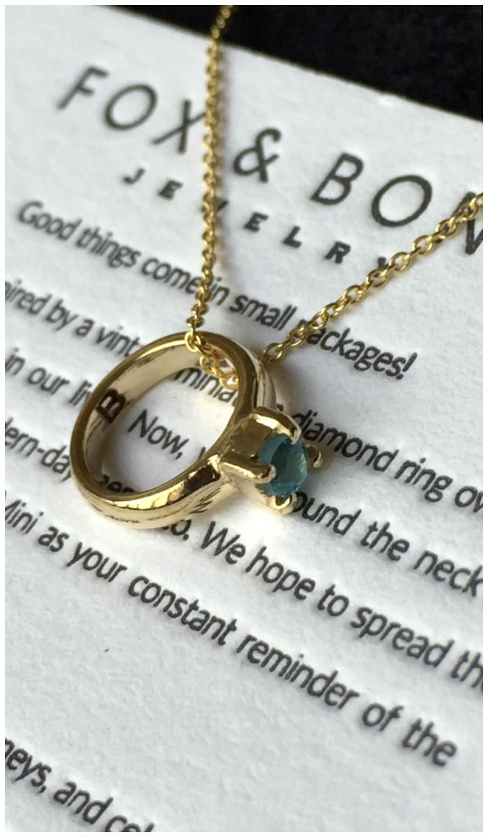 My Fox and Bond mini is in 14k yellow gold with an aquamarine, for my birthstone...
