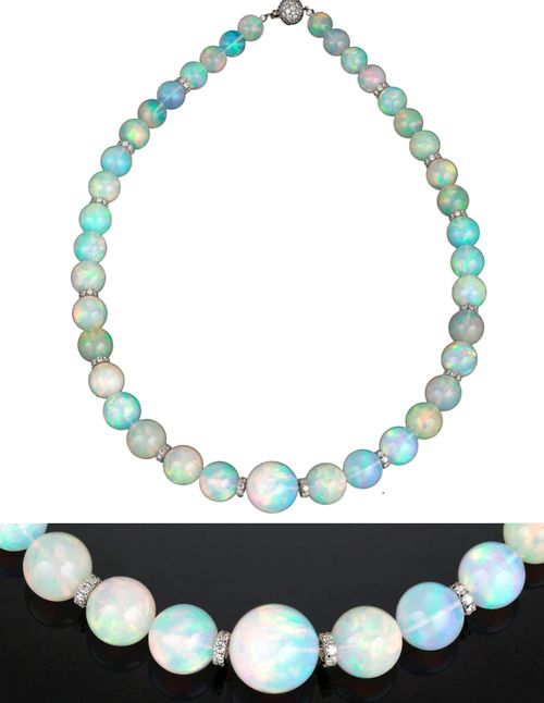 Thirty-nine incredibly rare and large opal beads, weighing an amazing 386.00 tot...