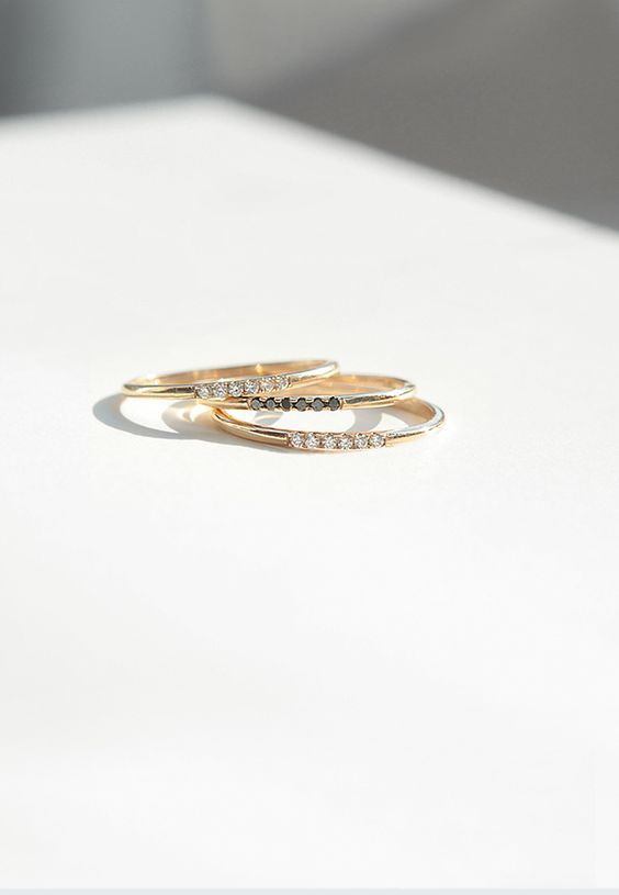 Fine stackable rings by Mejuri in 14k solid gold with diamonds and black diamond...