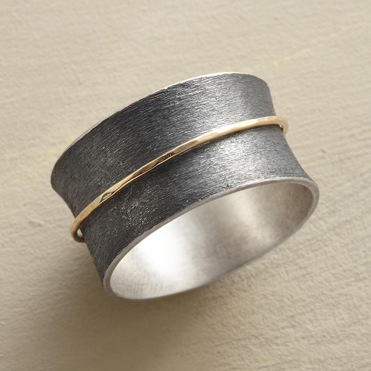 SPUN INTO GOLD RING -- Like a wisp of straw spun into gold, a 14kt ring spins on...
