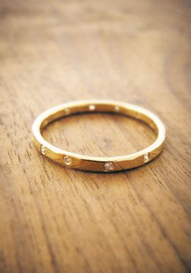 Gold wedding band with diamonds