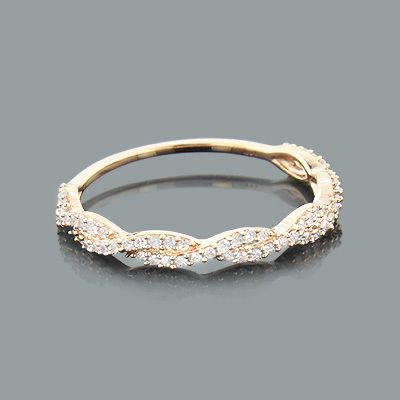 This Thin Stackable Designer Diamond Ring in 14K gold showcases 0.28 carats of s...