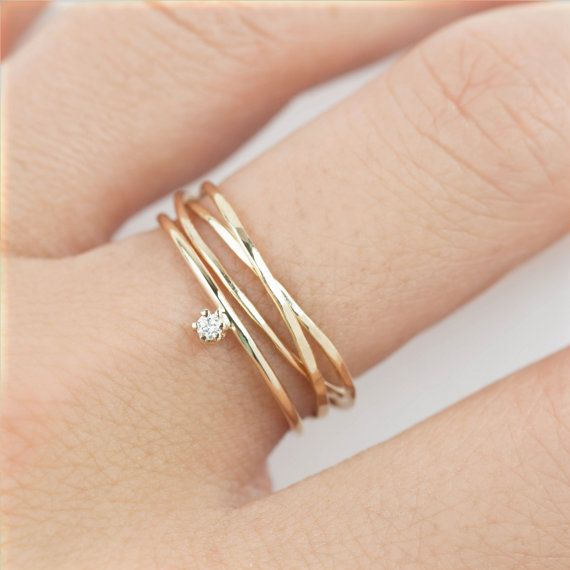 Gold streak trinity ring is made of intertwined 3 textured solid 14k gold rings ...