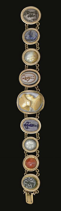 A BRACELET OF NINE ROMAN RINGSTONES CIRCA 1ST-2ND CENTURY A.D. Mounted together ...