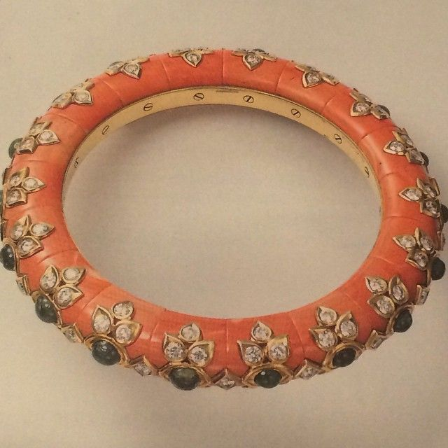 A Cartier coral, emerald, and diamond bracelet.
