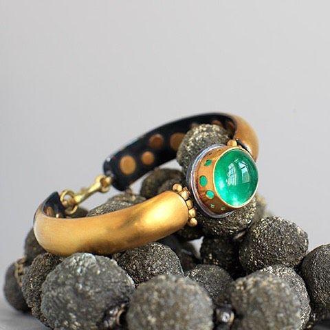 A beautiful 22 karat gold banded deep emerald cabachon bracelet, the emerald wit...