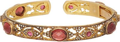A garnet, ruby, diamond, and 22 karat gold bracelet, by Cathy Waterman.