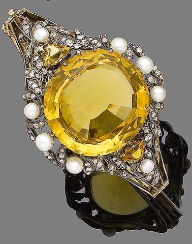 A late 19th century citrine, pearl and diamond bangle, circa 1890 The circular m...