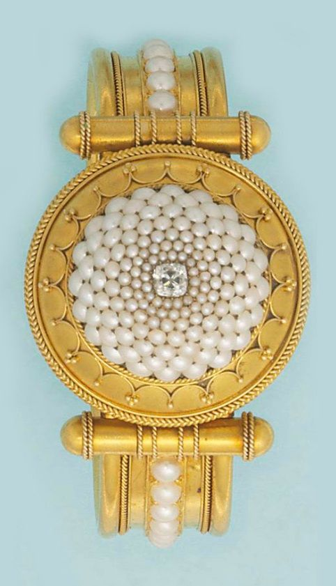 An Archaeological Revival gold and diamond bangle, circa 1830. Set to the front ...