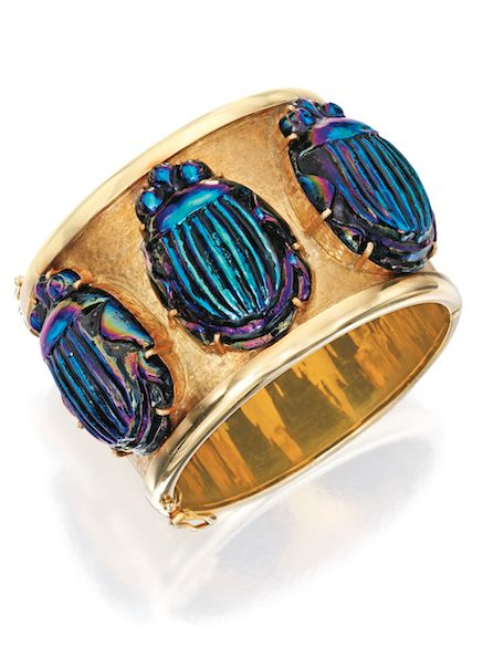 18 KARAT GOLD AND FAVRILE GLASS SCARAB BANGLE-BRACELET, PRIMAVESI & KAUFMANN The...