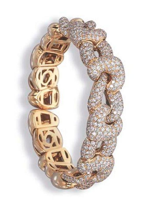 A DIAMOND BANGLE, BY BOUCHERON The pavé-set diamond intertwined heart-shaped li...