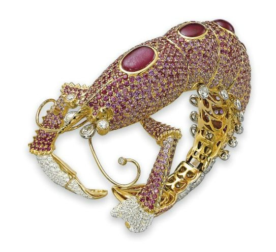 A STYLISH RUBY, PINK SAPPHIRE AND DIAMOND CRAYFISH BRACELET, BY AGGRAVI
