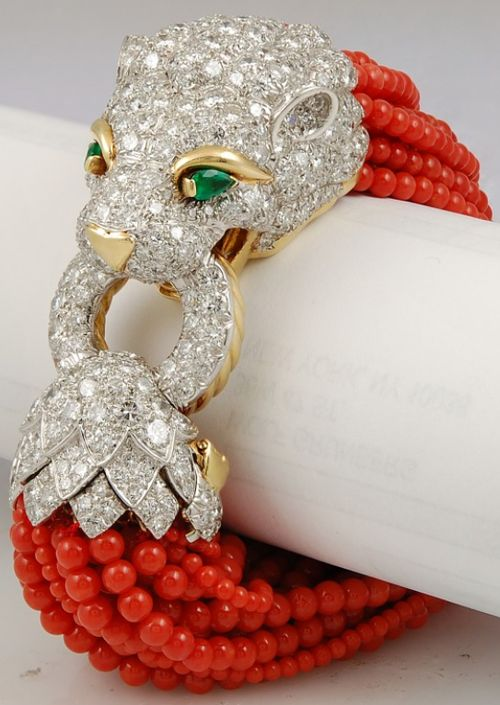 David Webb lion head bracelet in gold, platinum, and enamel with diamonds, emera...