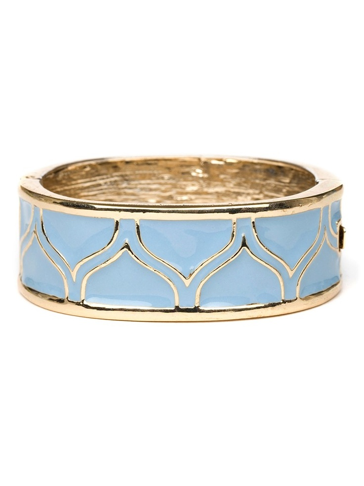 Dazzle plenty in this stylish cuff, which comes cast in sparkling gold and boldl...