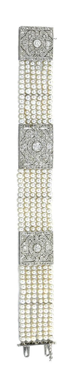 PEARL AND DIAMOND BRACELET,  CIRCA 1915.  Decorated with three open work plaques...