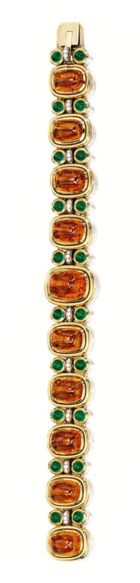 SPESSARTITE GARNET, EMERALD AND DIAMOND BRACELET, BULGARI. The bracelet composed...