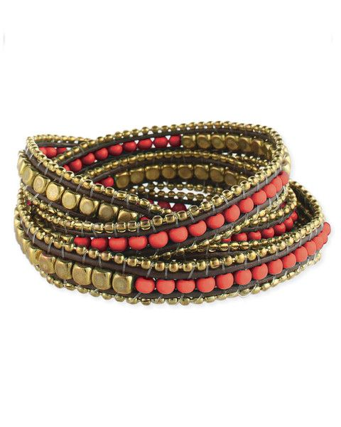 Featuring a single long strand of stunning gold and hued nugget beads that wrap ...