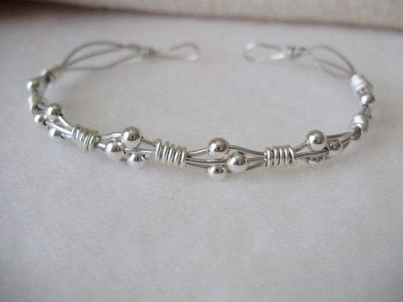 Wire wrapped bracelet. Super easy, but it doesn't look like it. What do you ...