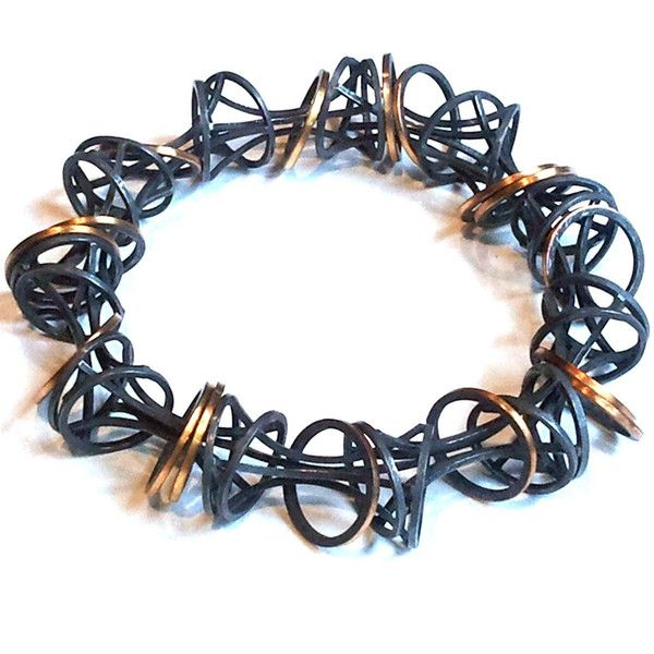 Verve Bracelet hand formed and fabricated in blackened sterling silver and 22k g...