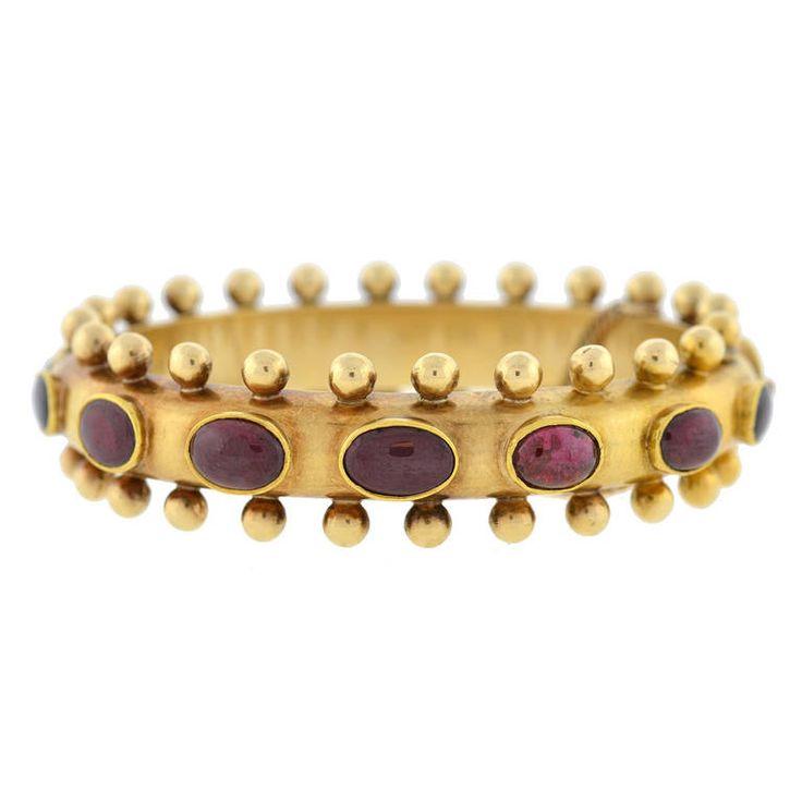 Victorian French Gold Bangle Bracelet set with cabochon garnets. Victorian era, ...