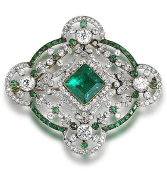 A Belle Époque emerald and diamond brooch/pendant, circa 1910.