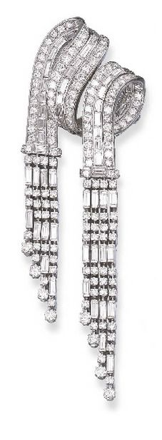 A DIAMOND BROOCH Designed as circular and baguette-cut diamond scrolled ribbons ...