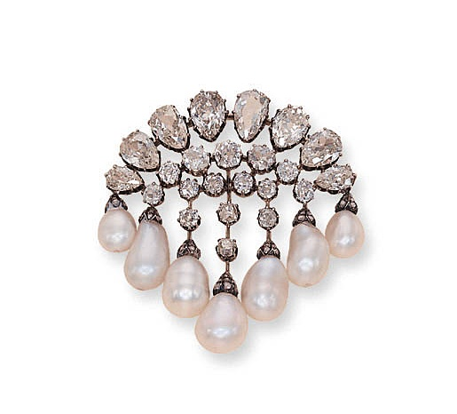 A STRIKING ANTIQUE PEARL AND DIAMOND BROOCH   Designed as a fringe of seven drop...