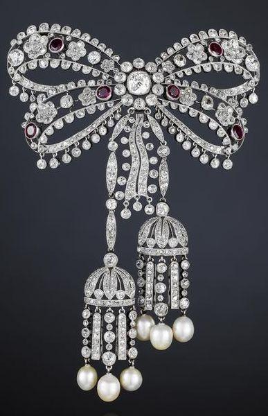 A fine belle époque diamond, ruby and pearl devant de corsage, by Cartier, circ...