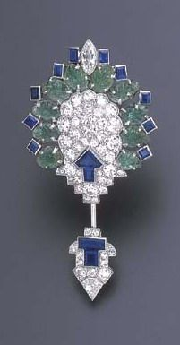 AN ART DECO EMERALD, SAPPHIRE AND DIAMOND JABOT BROOCH, BY CARTIER Of geometric ...