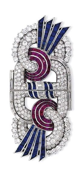 AN ART DECO RUBY, SAPPHIRE AND DIAMOND DOUBLE CLIP BROOCH - Of stylised figure-o...