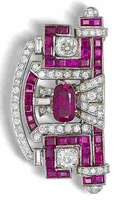 An Art Deco ruby and diamond plaque brooch, circa 1930. The central cushion-shap...