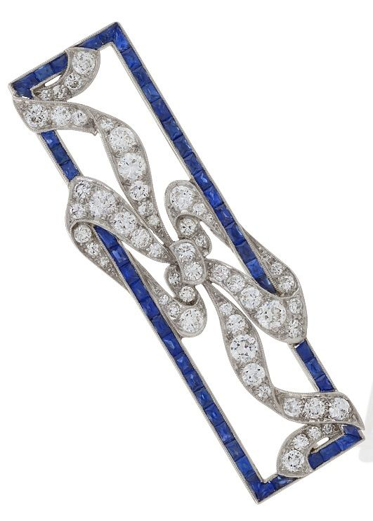 An early Art Deco Diamond, Sapphire and Platinum Brooch. Set with 55 round-cut d...