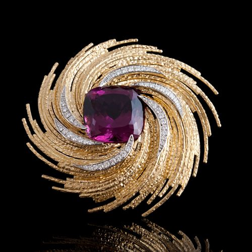 Andrew Grima - 18ct gold brooch with purple sapphire and diamonds.