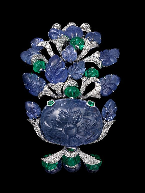 CARTIER Platinum, one 75.37-carat carved sapphire, melon-cut sapphire and emeral...