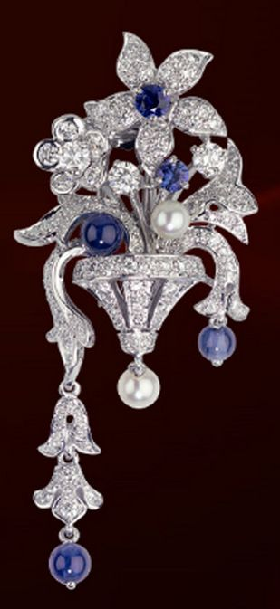 Cartier brooch in platinum with sapphires, pearls and diamonds.