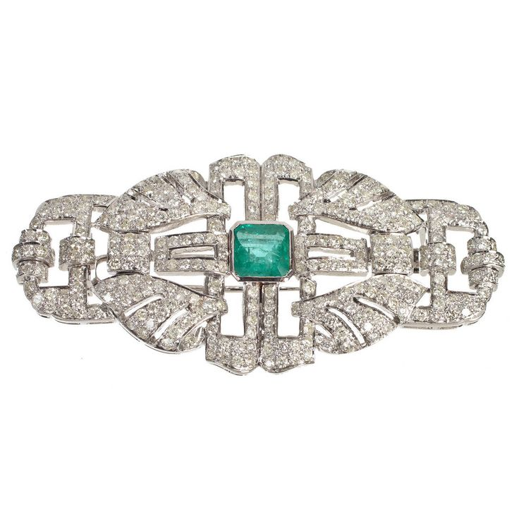 Emerald Diamond White Gold Brooch. This brooch is an exquisite example of a piec...