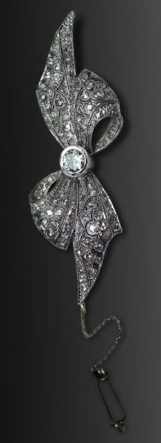*Exceptional Art Deco Platinum and Diamond Bow Pin.