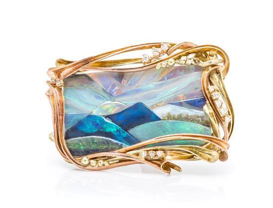 A 14 Karat Gold, Opal Mosaic and Diamond 'Sunset over Bali' Brooch, Ange...