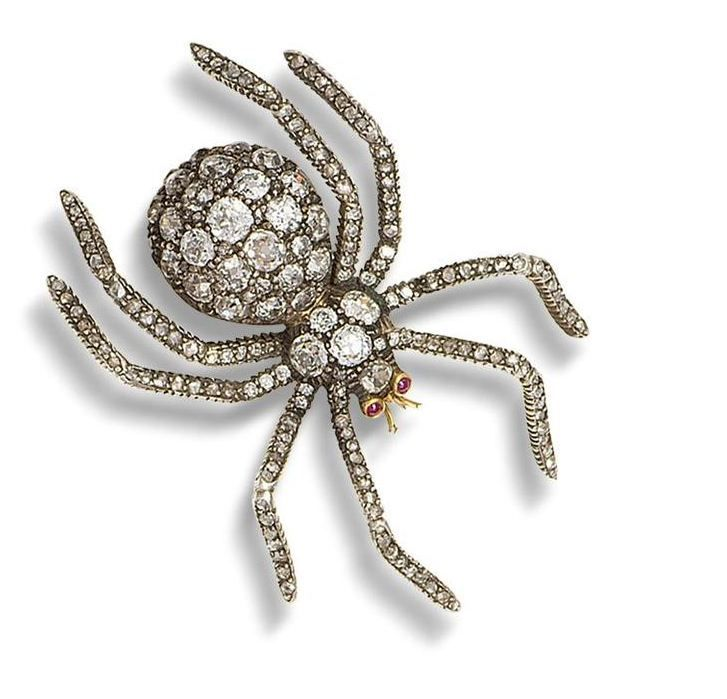 A diamond and ruby spider brooch, circa 1930
