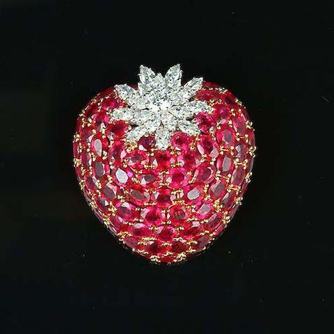 A ruby and diamond strawberry brooch.