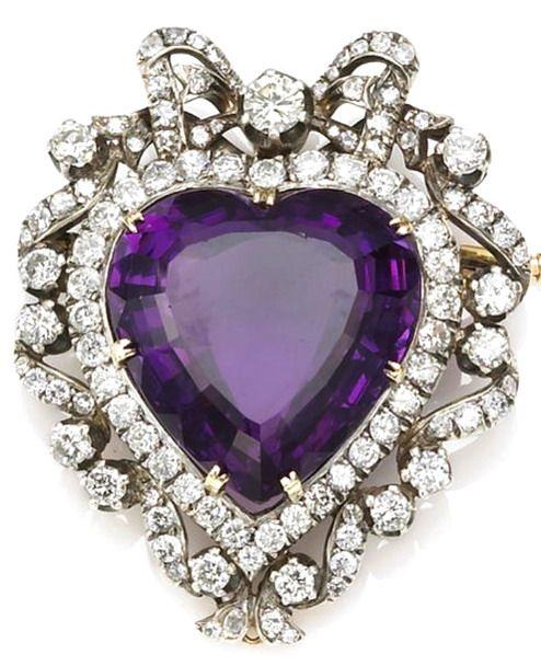 An amethyst and diamond brooch-pendant centering a heart-shaped amethyst; estima...