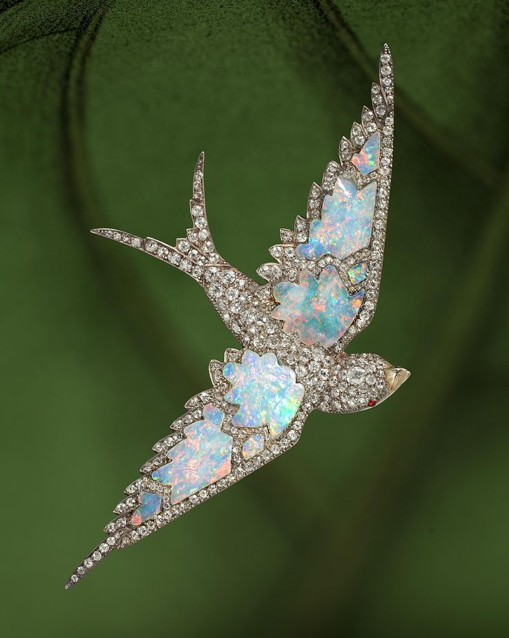 An antique opal and diamond swallow brooch, circa 1870 pavé-set with diamonds, ...
