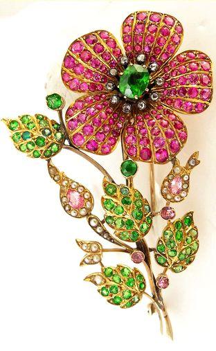 Antique Edwardian brooch pin. Demantoid garnets, rubies, pink sapphires, diamond...